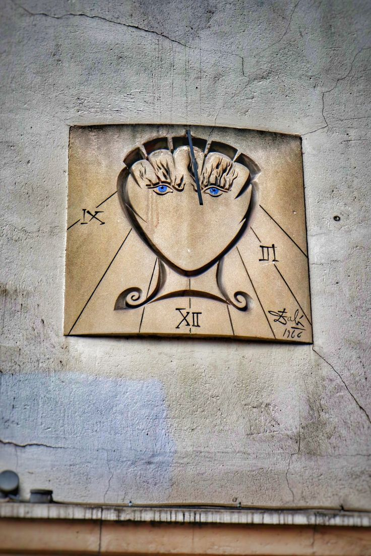 Salvador Dali sundial on the side of a building in the Latin Quarter of Paris