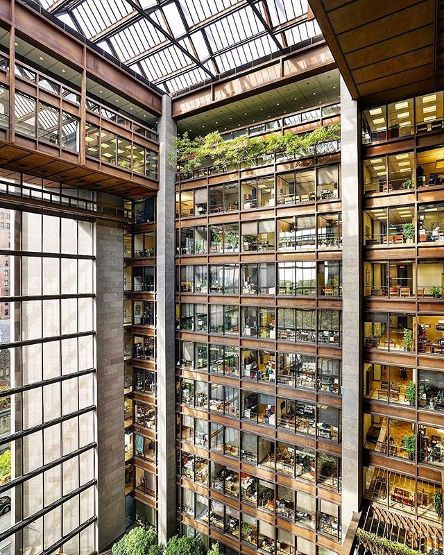 """At 48 years old, the 12-story atrium at the @fordfoundation is the """"youngest"""" interior landmark in NYC. An elegant, transparent glass cube equipped with Cor-Ten steel and mahogany-colored South Dakota granite, Kevin Roche John Dinkeloo and Associates' office building also features a terraced garden with trees, shrubs, and vines surrounding a pool of water. Go inside the Ford Foundation this #OHNYwknd for a chance to see the atrium from the above! #DailyReveal #newyorkisopen"""