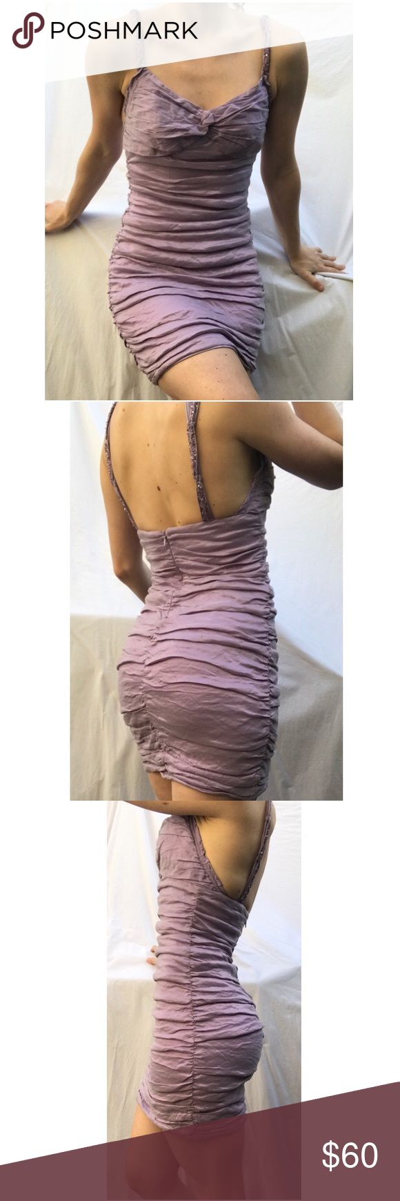 BCBG lilac lavender beaded ruched dress BCBG lilac/ lavender/ purple beaded and embroidered ruched mini dress. Great for formal, date night, club, dance, etc! Ruched style is very flattering! Pretty beading and embroidery! Worn only once to a formal. Light discoloration on the inside due to airbrush tan , absolutely no effect on look from the outside. Can get a photo for that asap! Dance the night away in this mini BCBG Dresses