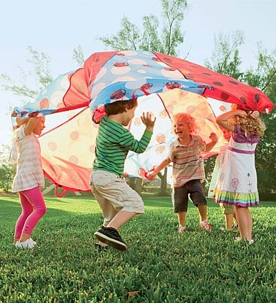 Ladybug parachute. Whimsical outdoor fun.