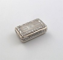 A George III oblong snuff box, with engraved decoration and fruiting vine borders, gilt interior and inscription 'To George Evrington Esquire from the Gentleman passengers of the Galconda Indiaman', by Thomas Pemberton and Robert Mitchell, London 1818, 2.5in (6.4cm) long, 2.2oz.  Estimate: £120-150  Hammer Price: £360  Lot: 151  Sale: Silver, Coins & Medals, and Silver from the estate of Lorna Rossi of Walter H Willson (SV290409)