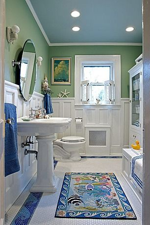 bathroom, full bathroom, kids bathroom, white, green, ocean, themed, paneling, wainscoting, wood paneling, radiator cover, mirror, round mirror, sink, toilet, window, bathroom window, shutters, bathroom storage, closet, linen closet