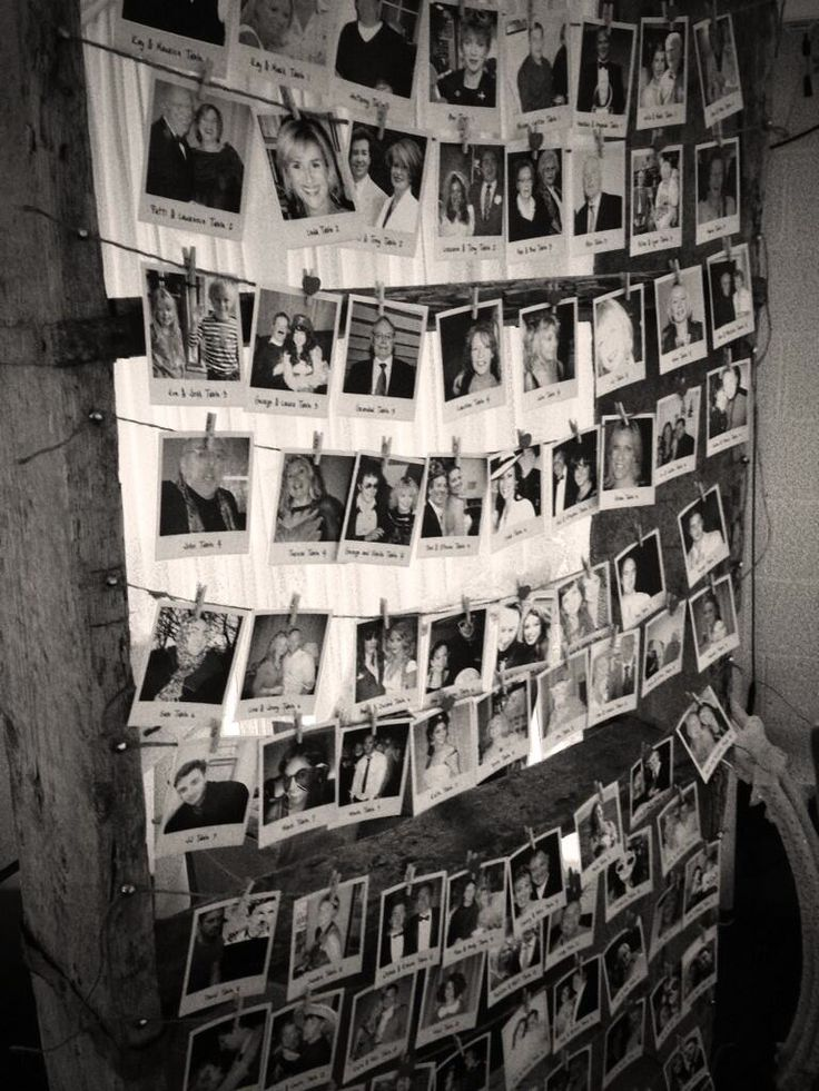 A lovely idea for a seating plan that uses photos of all the guests pinned using mini clothes pegs.