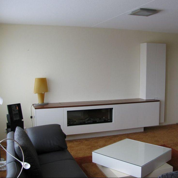 Elektrische haard in meubel met tv-lift