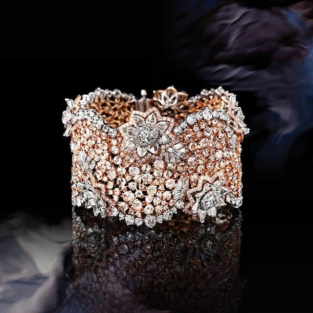 Inspired by the balance and symmetry of the lotus, the #Lotus Mesh #Bracelet is crafted with exceptional attention to detail and impeccable #poise. The purity of the lotus #flower is mirrored in the quality and clarity of the jewel's sparkling diamonds. True to the palette of the flower, this #collection uses a harmonious combination of #white and rose #gold, set with a bouquet of pink and white #diamonds to simulate the grace of the lotus flower. #DiamondJewellery