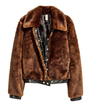Dark brown. Short jacket in soft faux fur with imitation leather details. Large collar, concealed snap fasteners at front, and side pockets. Imitation