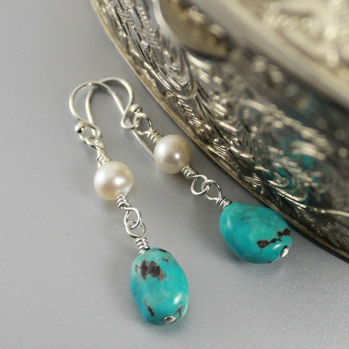 These earrings are made with genuine Nevada turquoise nugget gemstones and white freshwater cultured pearls with sterling silver earring hooks. - Nevada turquoise gemstones - White freshwater pearls -