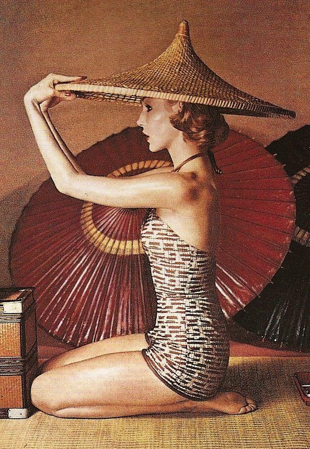 Harper's Bazaar, 1952, by Louise Dahl-Wolfe. Parasol and asian sun hat
