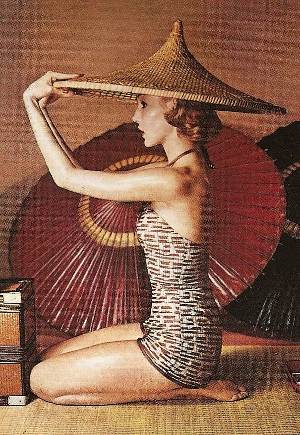 Harper's Bazaar, 1952, by Louise Dahl-Wolfe. Parasol and asian sun hat