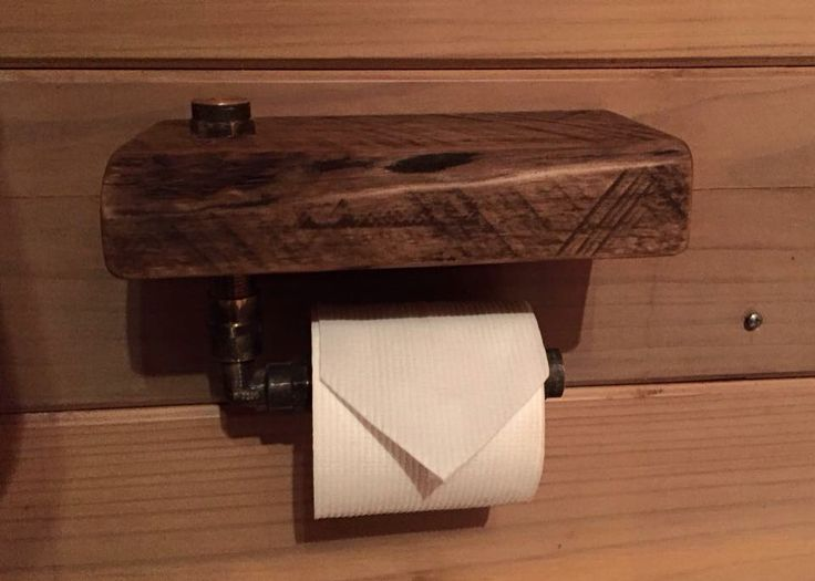 Rustic toilet roll holder from brass pipes and a chunky slab of timber