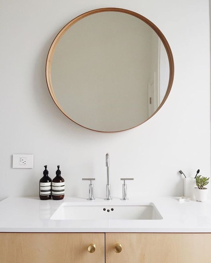 Round Mirror In Minimalistic Bathroom
