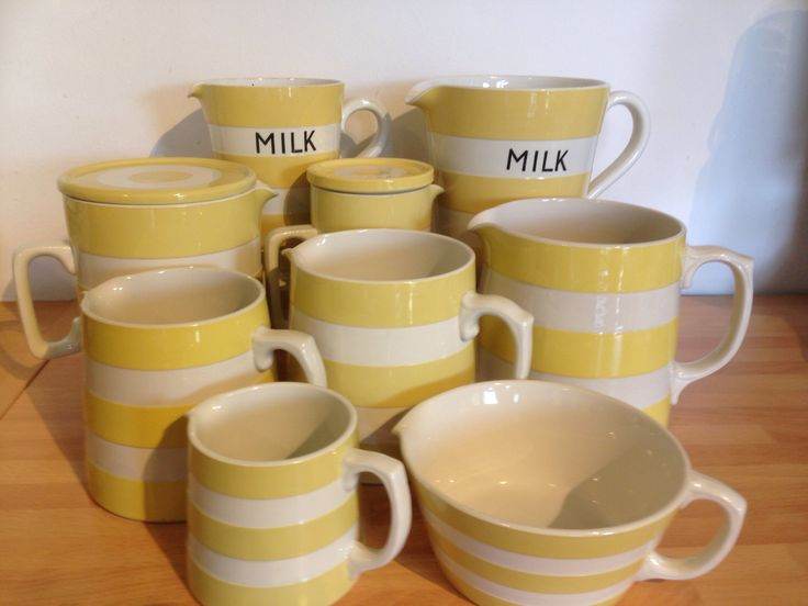 A selection of Cornishware yellow and white jugs.