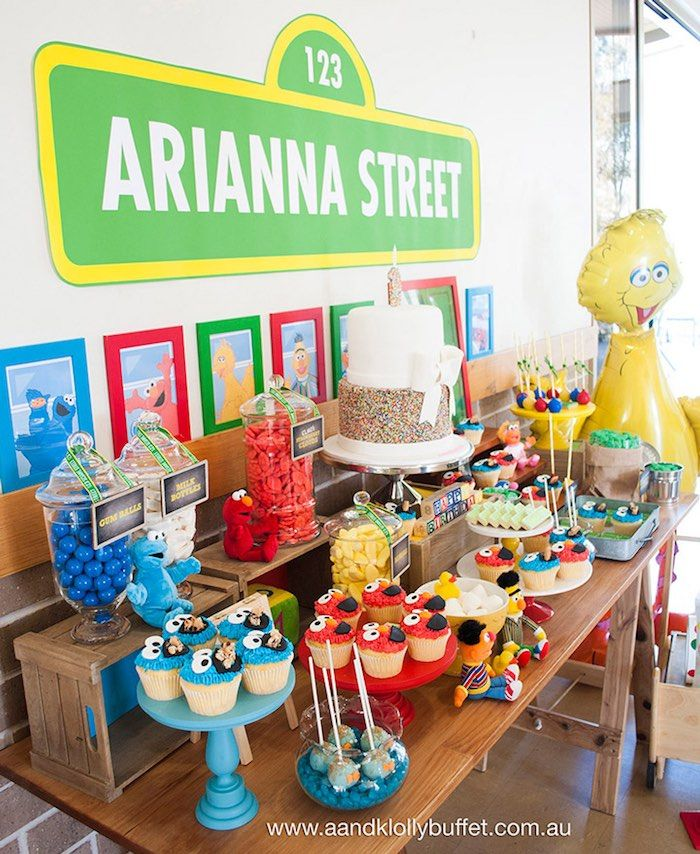 Side-view of the dessert table from a Vintage Sesame Street Birthday Party