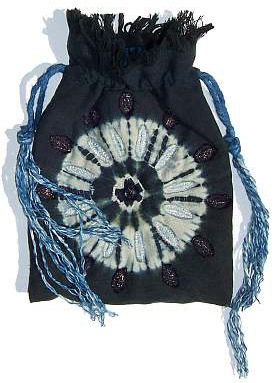 A bound design, ne-maki shibori combined with a kumo shibori variation, touched with embroidery.