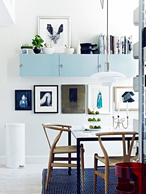 Light blue cabinets, great storage idea. Wall gallery idea