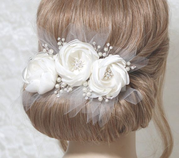 Three flower headpiece consists off white color satin organza floral leaves with rhinestone, pearls and tull, having a sense of volume. Flowers are decorated with rhinestone in the center. off white satin hair piece come attached to silver plated hair clip and pin . *** SIZE **** Approximately width 7  *** SHIPMENT *** Ships your order within 3-5 business days. It takes 10-15 business days to send all items via regular air mail service.   Thank you for looking~~! :)