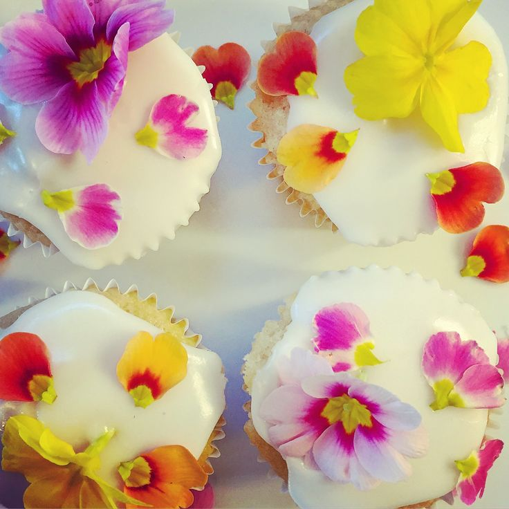 spring edible flowers decorating lemon curd filled cupcakes