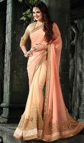 Peach Color Shaded Chiffon and Net Embroidered Sari #saridesigner #sariblouse Be the picture of ethereal perfection in this peach color shaded chiffon and net embroidered sarii. The ethnic lace and resham work for saree adds a sign of beauty statement for the look. Upon request we can make round front/back neck and short 6 inches sleeves regular saree blouse also. USD $ 175 (Around £ 121 & Euro 133)