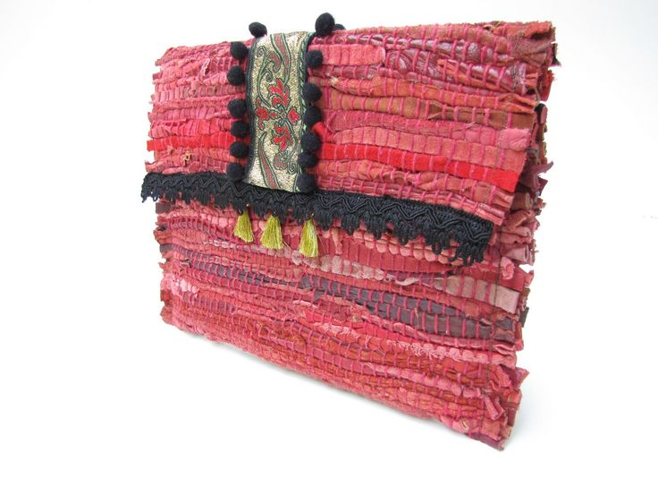 Clutch bag made from leather strips.