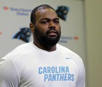 Michael Oher reports to Panthers minicamp