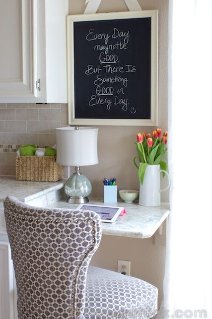 framed chalkboard quote/inspiration board in the kitchen..love the hanging ribbon feature.