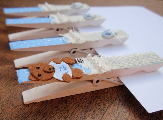 Baby Shower Clothespins optional magnets It's a Boy Theme with teddy bears and cute blue baby shoes by LaMiaBellaRose, $18.00  -Clips with magnets are perfect for hanging pictures of your new precious baby, baby shower announcements, to-do lists, important phone numbers, doctors notes, reminders, etc. -Give them as  party favors at your baby shower -Decorate your baby shower by clipping them to place cards, hang diapers or banners, or hang cards guest bring