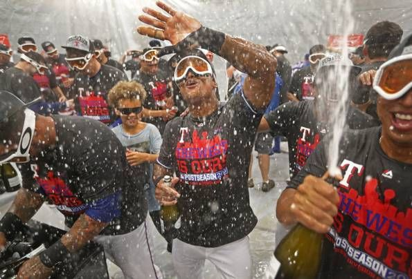 Texas Rangers players, including Adrian Beltre (center), dance together in the locker room after their 9-2 division-clinching win during the Los Angeles Angels vs. the Texas Rangers major league baseball game at Globe Life Park in Arlington on Sunday, October 4, 2015. (Louis DeLuca/The Dallas Morning News)