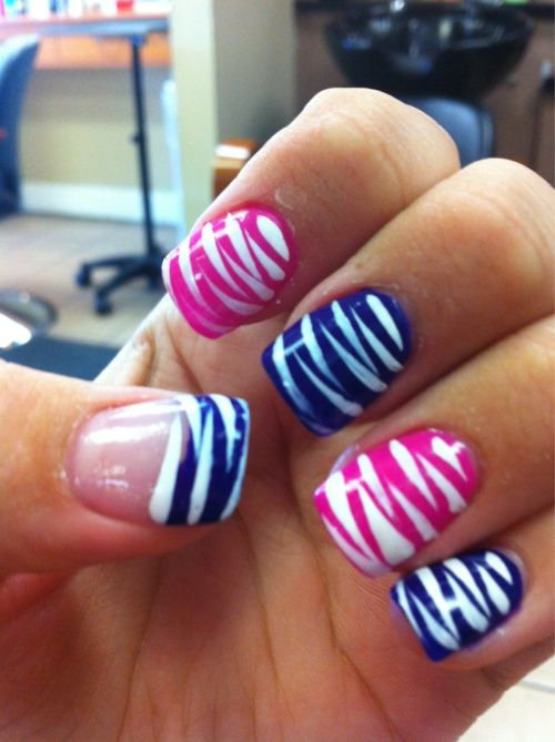 White, pink, and blue striped nails...