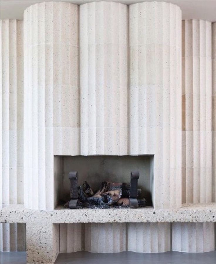 Fluted fireplace by Retrouvius apartment in Liverpool via adamnathanielfurman- apartment, interior