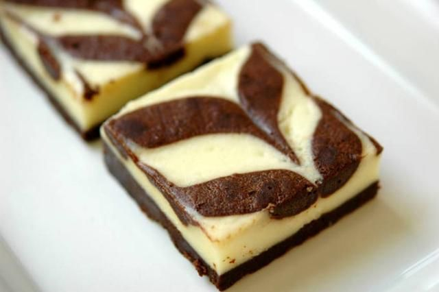 February 10th is National Cheesecake Brownie Day! Your mouth is already drooling with anticipation. #cheesecake #brownie #funusualholiday
