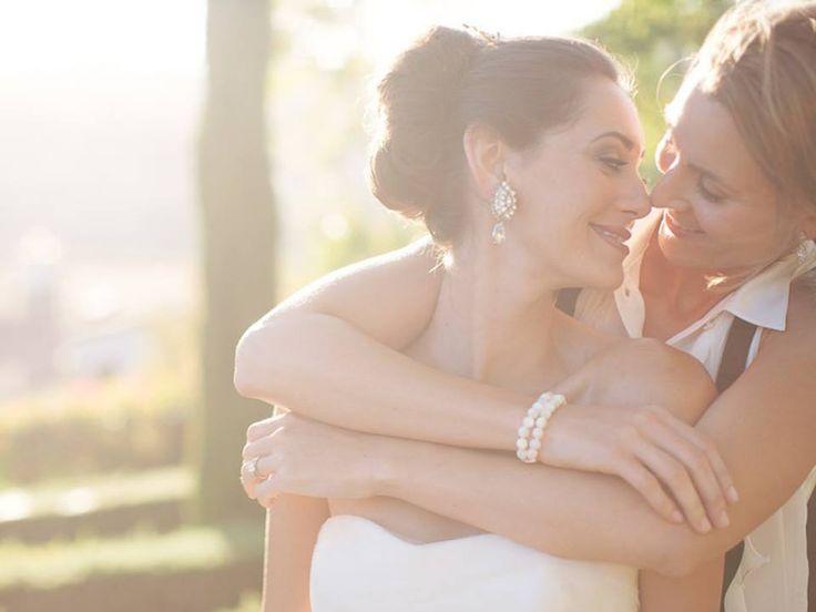 Sweet wedding photo from 2 gorgeous brides! http://www.pureblisswedding.com/ #lesbian #lesbianwedding @wedding #weddingplanner