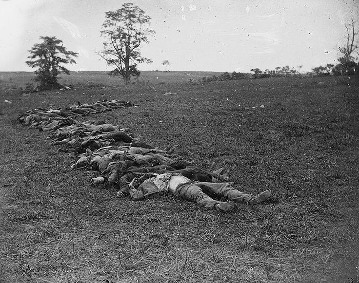 Bodies of Confederate dead gathered for burial after the Battle of Antietam, September 1862 Alexander Gardner/Mathew Brady
