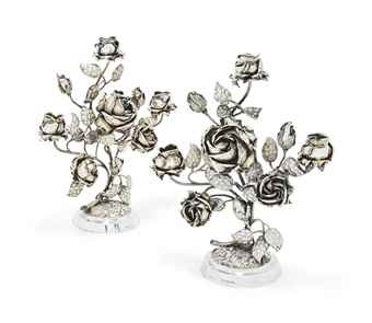 AN UNUSUAL PAIR OF VICTORIAN SILVER NOVELTY THREE-LIGHT CANDELABRA  MARK OF JOHN AND WILLIAM DEAKIN, LONDON, 1889