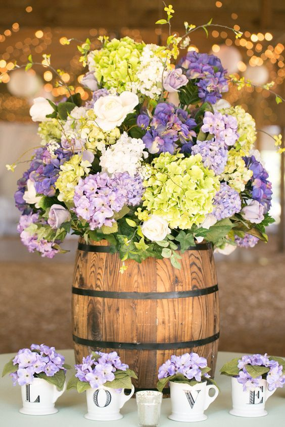 rustic wedding centerpiece via Amalie Orrange / http://www.himisspuff.com/tall-wedding-centerpieces/11/