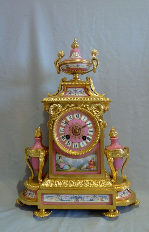 French antique mantel clock in ormolu and pink porcelain. ca.1870.