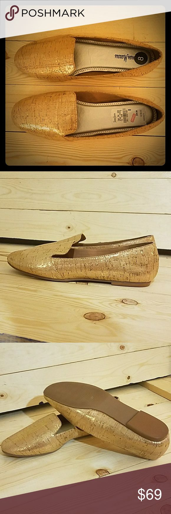 NEIMAN MARCUS Gold Mettalic Loafer Flat *NEW Fun shoe! Brushed mettalic gold flat in new condition. NEVER worn. Still has original pricing stickers in sole. Neiman Marcus Shoes Flats & Loafers