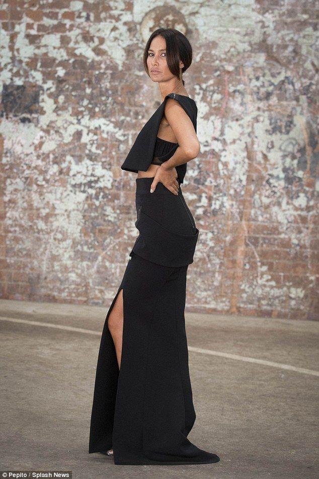 Trim and slim! Lindy Klim flaunts tiny waist in figure-hugging black dress with thigh-high...