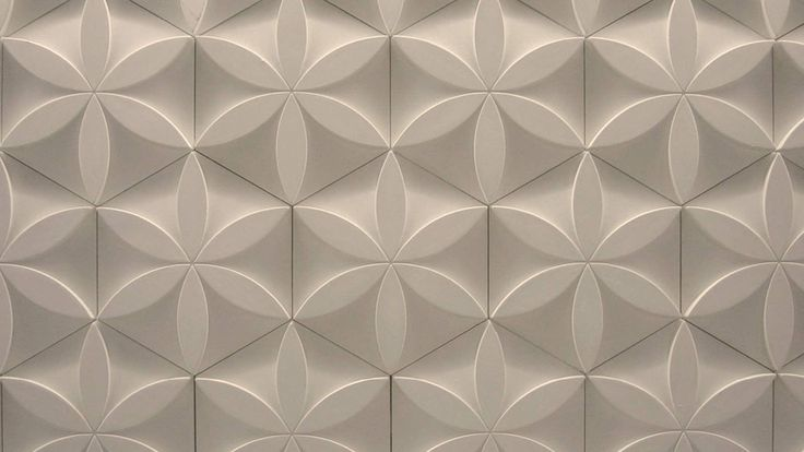 Barber & Osgerby and Universal looked to design a wall treatment loosely based around the idea of nature to give the store a rich, natural, textural feel. They combined a floral motif with a hexagonal cell-like pattern. By bringing the floral motifs forwards and placing them onto the receding hexagonal tile, the two patterns worked in tandem. Lit from above, the flowers stood out whilst the hexagons knitted the pattern together.