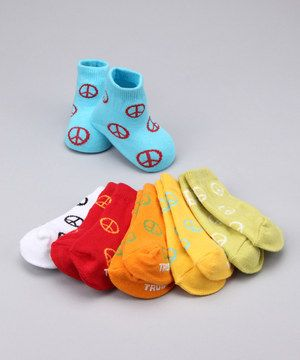 A mix of precious peace signs and vibrant colors make these socks a rockin' pick for any day of the week. Plus, the bumpy text on the soles adds a bit of grip, ensuring peaceful pitter-pattering.