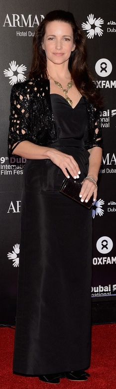 Who made  Kristen Davis' black gown that she wore in Dubai on December 14, 2012?