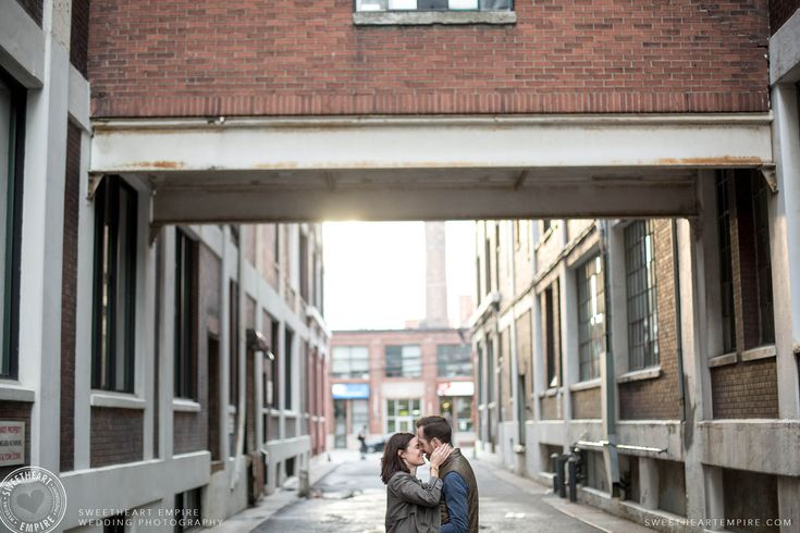 Couple kissing lovingly in an alleyway. Toronto Leslieville Engagement Photos #sweetheartempirephotography