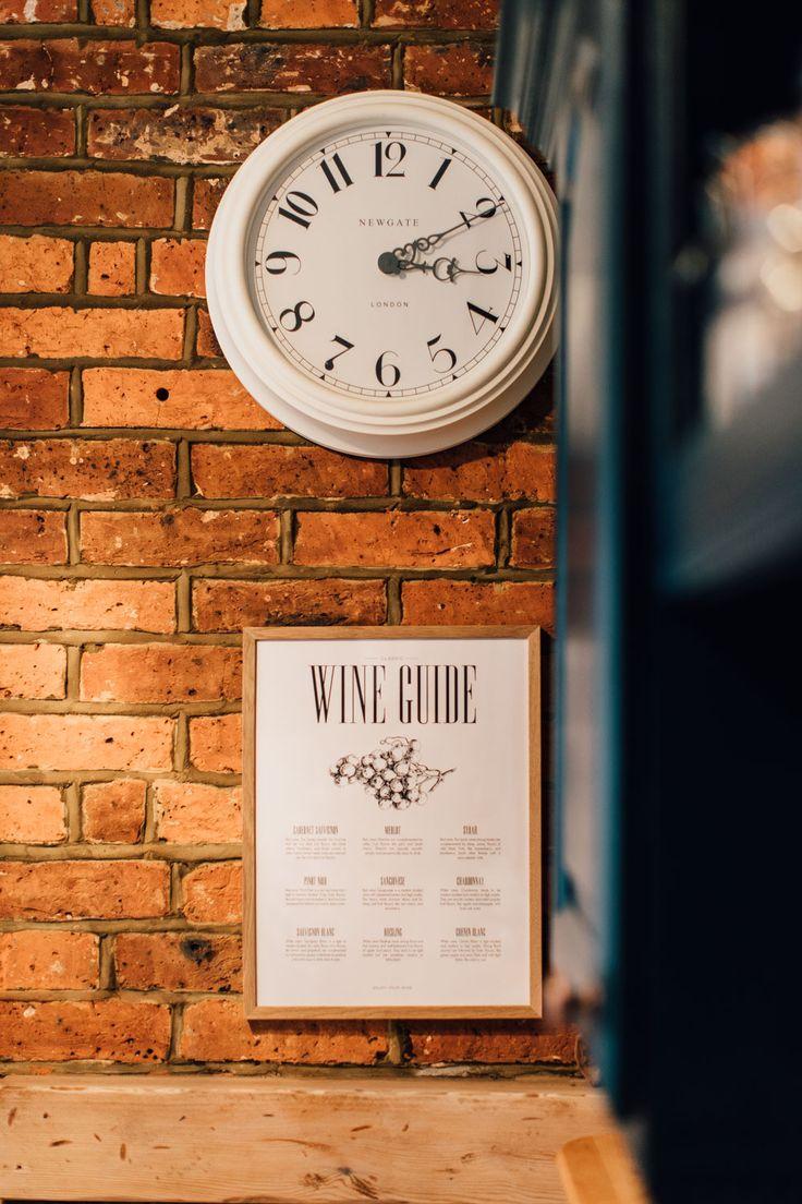 Kitchen clock on exposed brick wall