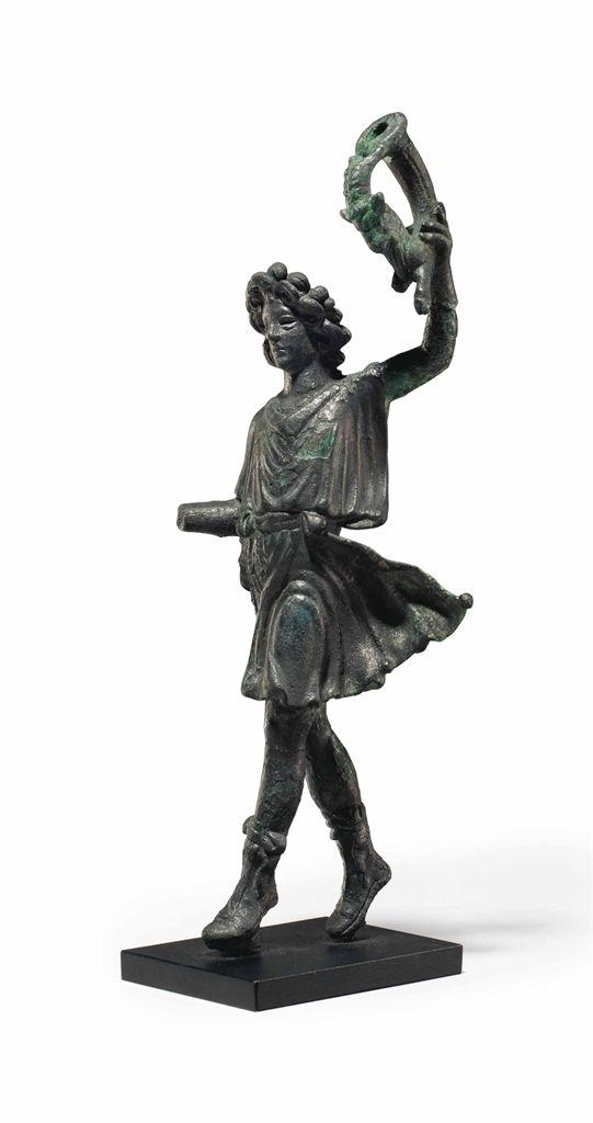 A ROMAN BRONZE DANCING LAR -  CIRCA 1ST CENTURY A.D.