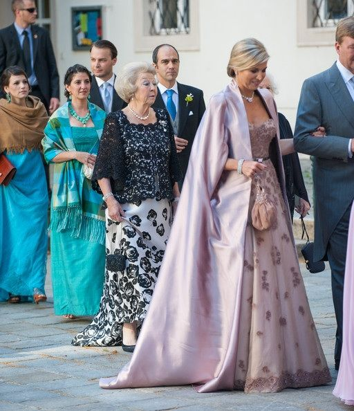 King Willem-Alexander, Queen Maxima and Princess Beatrix attend the wedding to her Majesty's brother Juan Zorreguietta to Andrea Wolfe in Austria. June 7, 2014