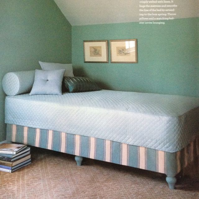 Make your own daybed out of a twin mattress set by adding wooden furniture legs to