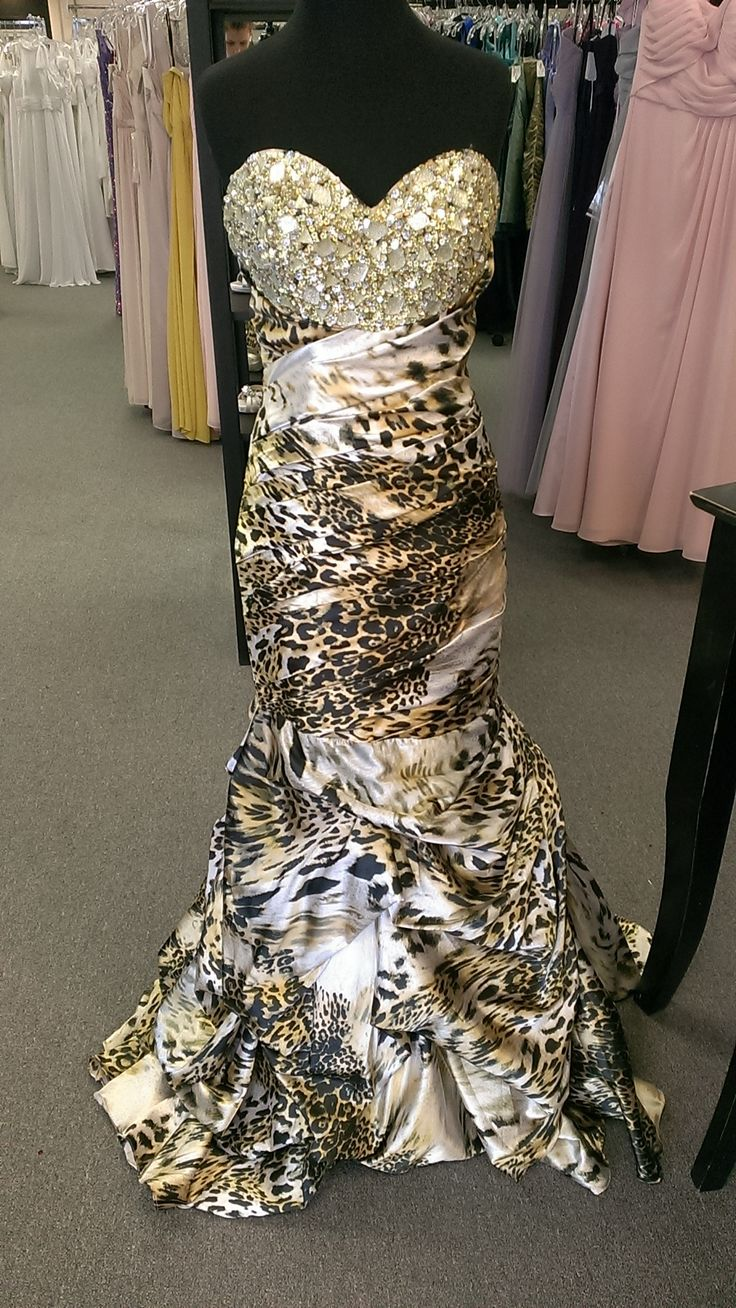 This leopard print dress is has a mermaid silhouette with soft ruching creating a gorgeous design. The bust is heavily beaded with a sweetheart neckline. The skirt of the dress has small pickups that