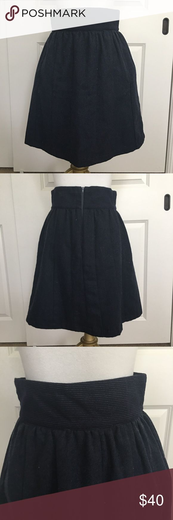 EUC Handcut by Preloved Butterfield Skirt EUC Handcut by Preloved Butterfield Skirt. Size Medium. Bought this beauty on consignment and so sad it doesn't fit me! Has slight vintage store smell. 🤗 Made from dark blue vintage wool trousers, fully lined (fun red lining) and pockets! Back zip closure. Since it's wool material, there is not a lot of stretch. Measurements (approximate and unstretched) are waist: 13.75' and length 21.5'. Made in Canada. Anthropologie Skirts