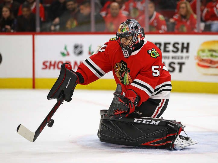 CHICAGO, IL - NOVEMBER 30: Corey Crawford #50 of the Chicago Blackhawks makes a save against the Dallas Stars at the United Center on November 30, 2017 in Chicago, Illinois. (Photo by Jonathan Daniel/Getty Images)