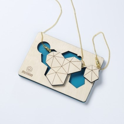 to wear architecture: facets wooden necklace + bracelet  / made with responsibly farmed birch wood / laser cut and hand treated with protective paint / hand painted blue on the back side  / 65cm brass chain necklace + 15cm chain bracelet with magnetic closures