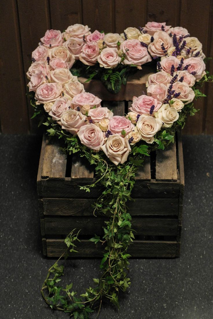 Funeral heart with roses and lavender.